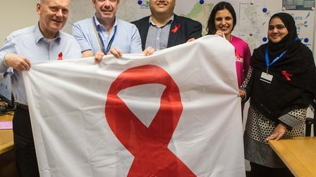 Poitive East charity members present mayor with World Aids flag for the town hall. Picture: LBTH
