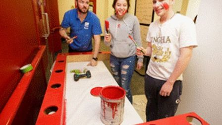 Volunteers give a lick of paint to Brady arts centre. Picture: Brady