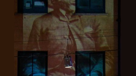 Image of Joseph Merrick, 'Elephant Man' of Victorian London, projected onto the building where he di