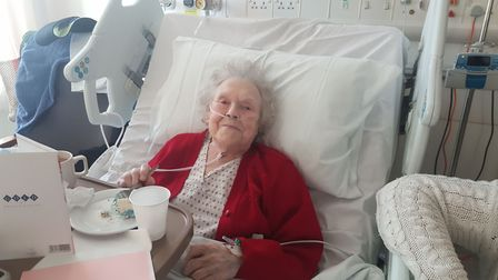 Florence, known as Flo, celebrating her 100th birthday with cake and balloons. Picture: Barts