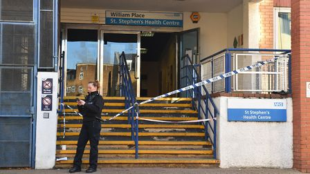 A police officer stands outside the St Stephen's Health Centre Picture: Dominic Lipinski/PA Wire