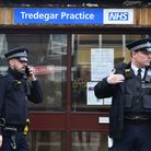 Police outside the Tredegar Practice in Bow. Picture: Dominic Lipinski/PA