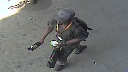 Dennis Boateng caught on CCTV with a wine bottle. Picture: City of London Police