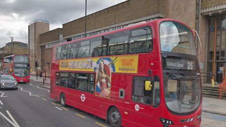 Two buses on the 25 route for Oxford Circus arriving together along Bow Road at Thames Magistrates C