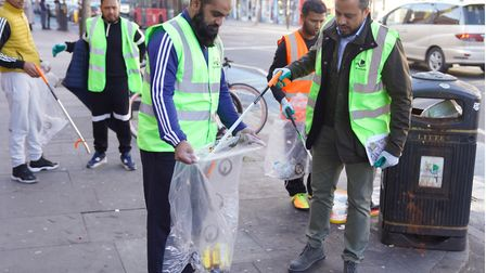 Tidying up along the Whitechapel Road, outside East London Mosque. Picture: LBTH