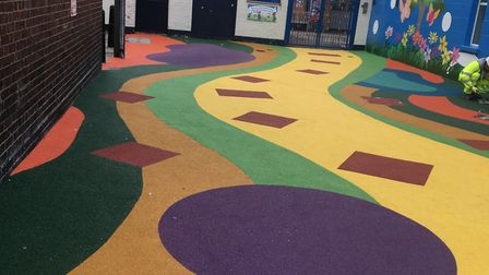 Creating a children's colourful play area in Salmon Street cul-de-sac outside their school. Picture:
