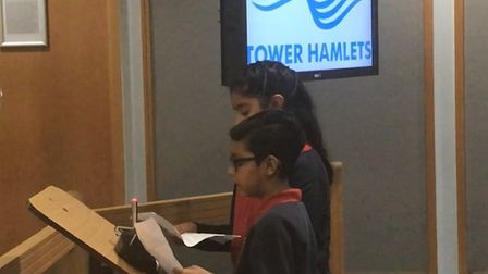 Two pupils from Lansbury School tell the council what they want done to tackle carbon emissions. Pic