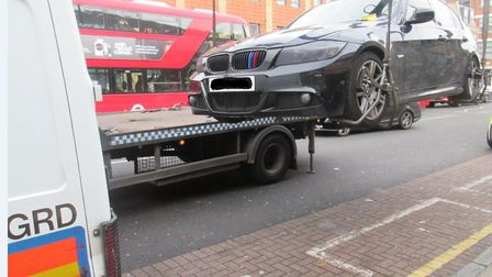 Suspect car being lifted in Operation Continuum to clear streets of Bethnal Green from drug-dealers.