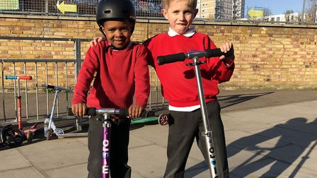 Micah and his scooter pal Gabrielus enjoying the moment riding in the street when traffic is banned.