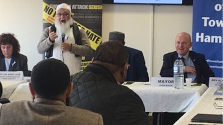 Security meeting addressed by Council of Mosques chairman with police commander (left) and mayor (fa