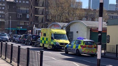Police and paramedics at the Crisp Street Market stabbing. Picture: @999London.