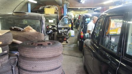 Taxi workshop under Liverpool Street railway arches in Bethnal Green, part of Network Rail's £1.4bn