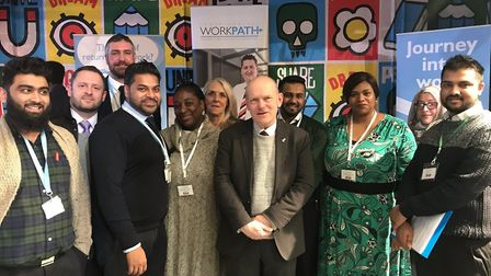 The WorkPath team who have found work for 1,000 people in 12 months, with mayor John Biggs (centre).