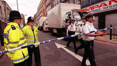 Police officers at the scene. Picture: PA Archives