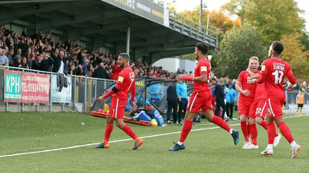 Leyton Orient captain Jobi McAnuff celebrates scoring away to Harrogate Town in front of the travell