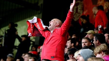 Leyton Orient fans sing during the National League match against Braintree Town at the Breyer Group
