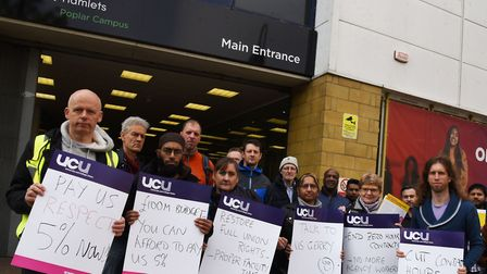 Pickets outside New City College in Poplar High Street at start of lectueres' three-day strike. Pict