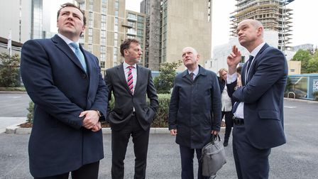 Mayor John Biggs, briefcase in hand, is shown round site of Wapping's new secondary school. Picture: