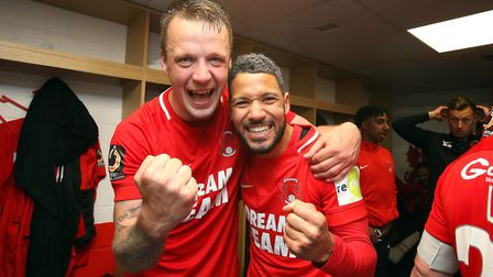 Leyton Orient centre back Josh Coulson (left) and Jobi McAnuff celebrate winning the National League