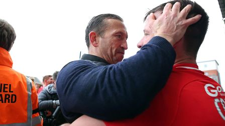 Justin Edinburgh celebrates with Leyton Orient defender Josh Coulson after promotion to the Football
