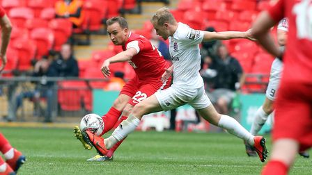 Charlie Lee looks to find a Leyton Orient team-mate in the FA Trophy final against AFC Fylde at Wemb
