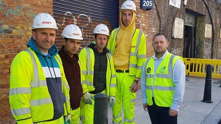 Road gang in Bethnal Green who've been fixing the dodgy pavement by the railway arches in Three Colt