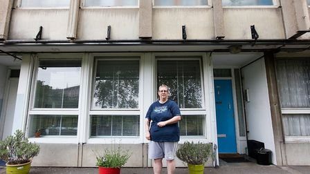 Joanne Newman-Stackable... ground-floor tenant with her potted plants. Picture: Kois Miah