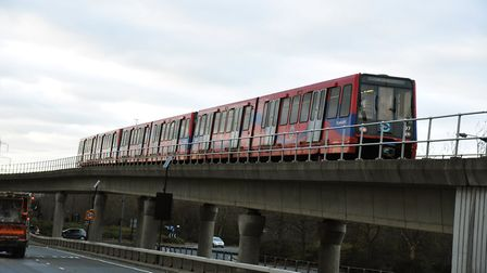 The trio are accused of gluing themselves to a DLR train. Picture: Ken Mears