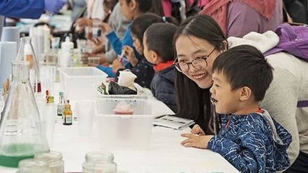 Families join in Queen Mary's research at last year's Festival of Communities. Picture: Jonathan Col