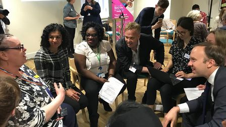 Secretary for Health Matt Mancock (right) speaks with NHS staff at the Tower Hamlets Centre for Ment