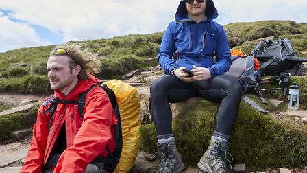 Made it! Tough volunteers reach Brecon Beacons summit. Picture: Taylor Wimpey