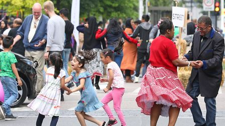 Children join mums and dads for dancing in the street at St Paul's Way Festival. Picture Rehan Jamil