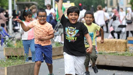 Children on the run in a street garden created by Public Works arts and architecture practice. Pictu
