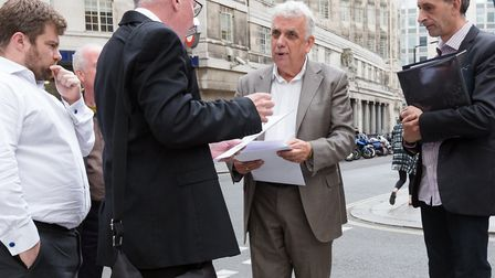 Erlam outside New Scotland Yard in 2015 to hand in evidence of Tower Hamlets corruption after winnin
