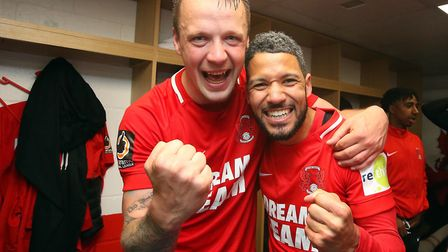 Josh Coulson (left) and Jobi McAnuff celebrate after Leyton Orient's promotion to the Football Leagu