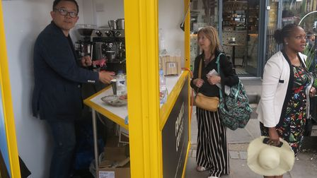 Frank serving his first customer in his new 'coffee cabin' at Bethnal Green station. Picture: Mike B