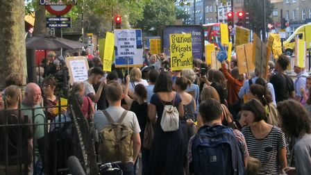 Rally with banner-waving protesters last summer when Frank was pushed out of business. Picture: Dan