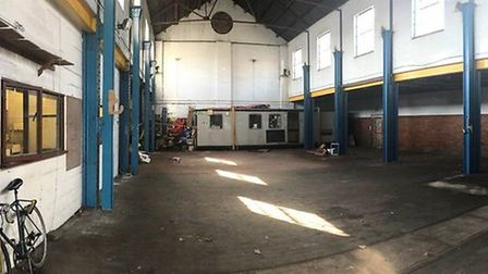 The old tramshed-turned-trolleybus depot in the 1950s used as a warehouse since 1961 now being spruc