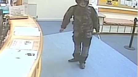 Dramatic picture of Jeffrey Shing-lok Leung armed with a knife at one of the GP surgeries in Bow whe
