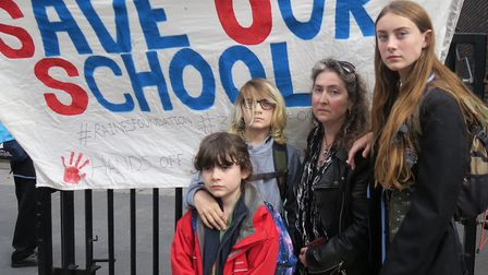 Matilda Rose, 14, (far right) fighting to keep 300-year-old Raine's Foundation going... protesting w