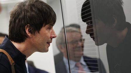 TV's Prof Brian Cox and Lord Mawson look in at the new pharmacy in Bow Common using robot technology