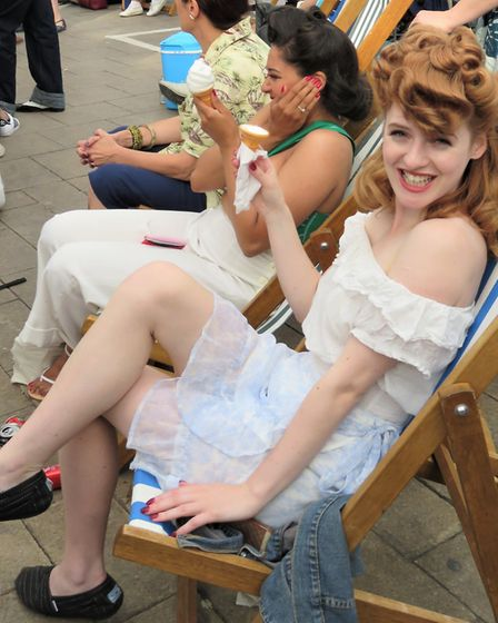 Enjoying an ice-cream in the heatwave in your best glad rags at Swing East retro festival. Picture: