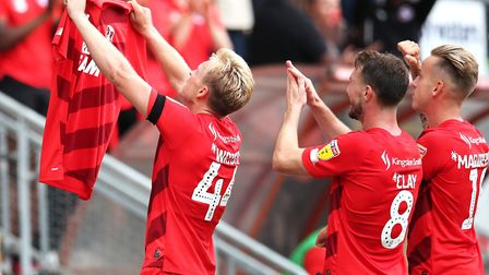 Leyton Orient's Josh Wright (left) celebrates scoring his side's first goal during the League Two ma