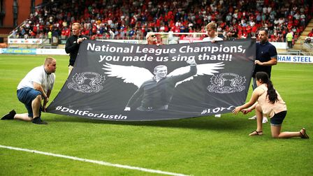 O's fans hold up a banner in tribute to former Leyton Orient manager Justin Edinburgh before the Lea