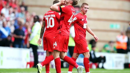 Leyton Orient's Josh Wright celebrates in front of Justin Edinburgh's family after scoring his side'