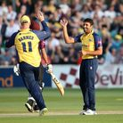 Ravi Bopara of Essex celebrates with Vitality Blast captain Simon Harmer after taking the wicket of