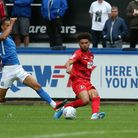 Leyton Orient forward Lee Angol looks to play the ball into a dangerous area against Macclesfield To