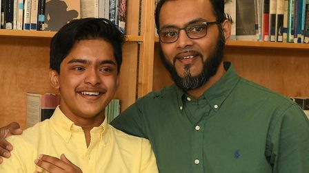 Top achiever Jakaria Khalil with his dad Khalil Uddin Ali. Picture: George Green's School