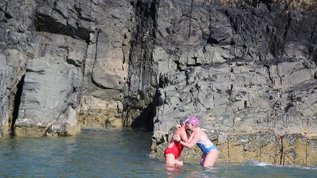 Samantha and her mum Emmy Poulsen hugged and cried when they reached the rocks at the end of the swi
