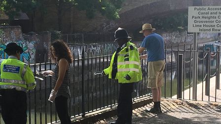 Police join in to help create a safer place by the Limehouse Cut. Picture: LBTH